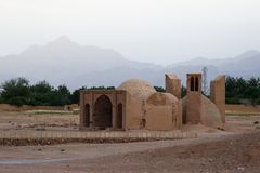 Ancient sandy house in the traditional style of Iran stock photography