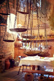 Ancient scales against vintage utensils Royalty Free Stock Photo