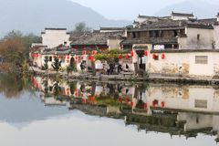 Idyllic reflections at the riverside in ancient water village Hongcun (Unesco), China. Ancient picturesque water village Hongcun along the lake in the province Stock Photos