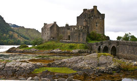 Ancient scottish castle. Eilean donan castle on a cloudy day at low tide Royalty Free Stock Image