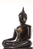 Ancient scratch black buddha isolated Stock Photography