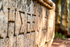 Ancient script hieroglyph carved on stone block in Athens, Greece Royalty Free Stock Images