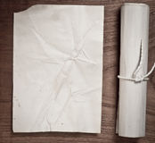 Ancient scroll with paper on wood table. Ancient scroll on wood table, top view Royalty Free Stock Photography