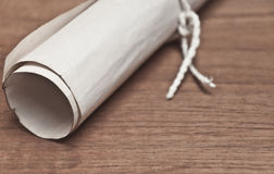 Ancient scroll on wood table. Closeup Stock Image