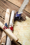 Ancient scrolls writing by feather with blue ink Royalty Free Stock Images