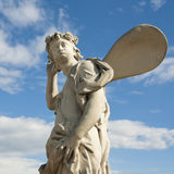 Ancient sculpture angel in the blue sky. Royalty Free Stock Images