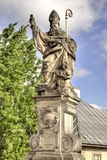 Ancient sculpture on the Charles Bridge. Prague. Blessed St. Aug Stock Photography