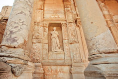 Ancient sculpture at entrance of historical Celsus Library of Ephesus city, Turkey. Greek city Ephesus founded on 10th century BC Royalty Free Stock Photography