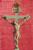 Jesus Christ INRI saviour of Christians. Ancient  sculpture of Jesus on the cross with sign INRI above his head Stock Photography