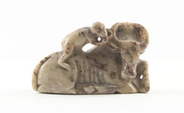 Ancient sculpture made of stone. That represents monkey riding a bull royalty free stock images