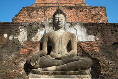 Ancient sculpture of a sitting Buddha close up. Fragment of ruins of the Buddhist temple Wat Mahathat. Sukhothai, Thailand Stock Image
