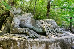 Ancient sculpture, Sleeping Girl, at the famous Parco dei Mostri, also called Sacro Bosco or Giardini di Bomarzo stock photos
