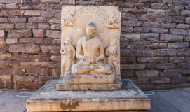 Ancient sculpture/statue of Gautam Buddha meditating. Ancient stone sculpture/statue of Gautama Buddha meditating peacefully at Sanchi. Some of its part are royalty free stock images