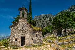 Ancient Serbian church. Ruins and mountain valley landscape near Kotor castle fortress wall in Montenegro Stock Image