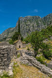 Ancient Serbian church ruins. And mountain valley landscape near Kotor castle fortress wall in Montenegro Royalty Free Stock Photo