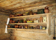 Ancient shelf for kitchen utensils. Stock Photo