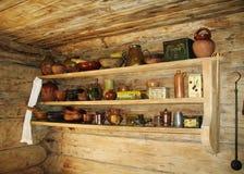 Ancient shelf for kitchen utensils. Shelf for kitchen utensils in ancient russian kitchen Stock Photo