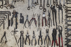 Ancient shelf of pliers Stock Photos