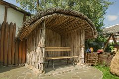 Ancient shelter from the reeds. Summer sunny day. Ukrainian Folk Museum Royalty Free Stock Photos