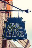 Ancient shield of a currency exchange on house wall Royalty Free Stock Photography
