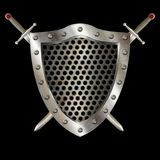 Ancient shield with two swords. Medieval riveted shield with riveted border, metal grid and swords on black background Stock Photo
