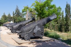 Ancient ship cannons. Russia, the Republic of Crimea, the city of Sevastopol. Antique cast-iron muzzle-loaded guns on Malakhov Hill royalty free stock images