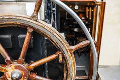Ancient ship steering wheel close-up photo Stock Photography
