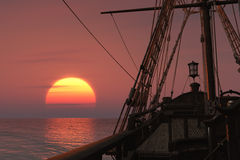 Ancient ship at sunset Stock Photography