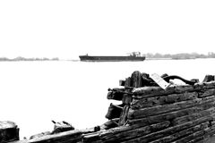 Ancient ship wreckage and container ship Royalty Free Stock Images