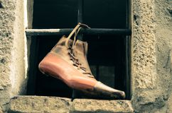 Ancient shoe in the workshop of a craftsman. Antique style footwear in a shoe craftsman`s workshop Stock Photo