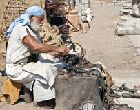 Ancient shoemaker. Reconstitution of the work of the ancient shoemakers, in the old city of Ephesus, Turkey Stock Photo