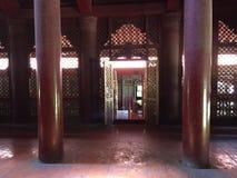 Ancient Shwe Inbin Monastery, in teak wood. Mandalay, Myanmar. Detail of the Ancient Monastery of Shwe Inbin, built with black teak wood and carved by hand stock image