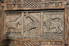 Ancient signs. Of giraffe, lion and horse stock photography