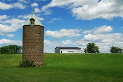 Ancient silo and barn Stock Photos