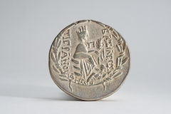 Ancient Silver Coin. Obverse of rare ancient coin on neutral color background Royalty Free Stock Image