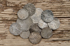 Ancient silver coins. Ancient English silver coins on an oak table Royalty Free Stock Images