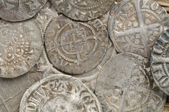Ancient silver coins. Ancient English silver coins close up showing lots of detail Stock Image
