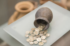 Ancient silver coins on a clay amphora Stock Photo