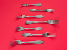 Ancient silver forks collection. On red background stock photo