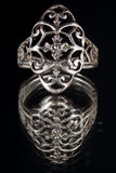 Ancient silver ring. On grey background Stock Photo