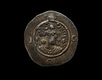Ancient silver Sassanian coin isolated on black royalty free stock images