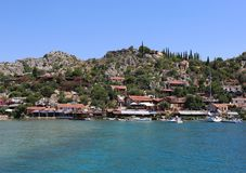 Ancient Simena Village with Houses and Yacht Stock Photo