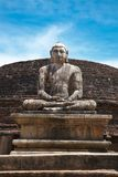 Ancient sitting Buddha image Stock Photo