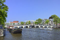 The ancient 'Skinny Bridge' in Amsterdam canal belt. AMSTERDAM-AUG. 19, 2012. Drawbridge on Aug. 19, 2012 in Amsterdam. It is known as Venice of the North. The Royalty Free Stock Images