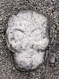Ancient skull stone sculpture embedded in ground of the ball court at Coba Mayan Ruins, Mexico Royalty Free Stock Photography