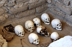 Ancient Skulls. Skulls and bones in Chauchilla, an ancient cemetery in the desert of Nazca, Peru. The remains of many Stock Photography