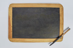 Ancient slate and slate pencil. Was used in school before we have books Stock Photography