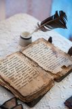 Ancient Slavonic prayer book. With Cyrillic symbols at the table Royalty Free Stock Photo
