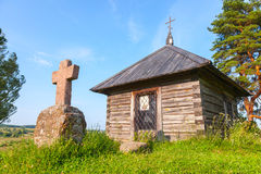 Ancient small wooden Orthodox chapel and cross Royalty Free Stock Photos
