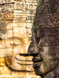 Ancient smiling stone face Stock Photography